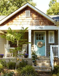 A home doesn't need to be big.  Just filled with love!    (A robin's egg blue door doesn't hurt:)