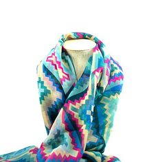 This Vibrant tribal print Scarf with turquoise, magenta and teal highlights will add color and life to every outfit. Available in our Loving Life Gift package.  #scarf #fashion #style #gift