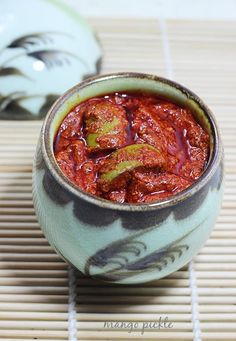 Mango pickle is a spicy condiment made with raw mango, spice powders, salt, garlic & oil. This instant mango pickle is the best to make easily Indian Pickle Recipe, Pickle Mango Recipe, Pickle Vodka, Indian Food Recipes, Vegetarian Recipes, Cooking Recipes, Indian Foods, Paneer Recipes, Cooking Tips