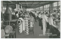 Employees of the John B. Stetson company finishing soft hats in the factory near 5th and Montgomery Avenues.