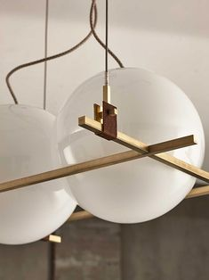 lighting in brushed and burnished brass and leather, from Milan based designer Federico Peri.