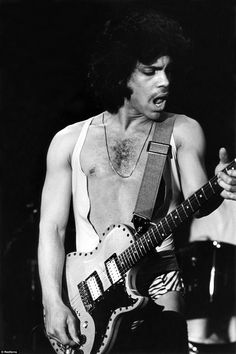 The singer had no fear of showing his body as he wore a ripped vest and leopard print shorts as part of the Dirty Mind Tour in March 1981 Prince Images, Leopard Print Shorts, Roger Nelson, Prince Rogers Nelson, Purple Reign, 50 Shades Of Grey, Most Beautiful Man, Like4like, Tank Man