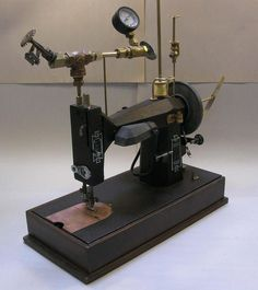 """Becky Stern's Steampunk Sewing Machine still functions as a sewing machine -- & the superfluous propellor spins when the drive-wheel moves! """"I got an old sewing machine at goodwill & steamed it up with brassy bits!"""""""