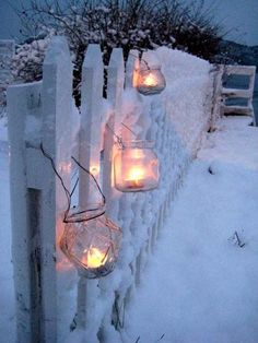 I love Christmas and Winter in New England!!! Bebe'!!! Great idea to hang the lanterns on the picket fence!!! So cozy and festive!!!