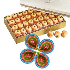 Treat your loved ones to a rich assortment of uniquely blended.This Kaju Apple Sweets With Decorated Diyas combo, Sweet Gift for everyone in this hamper.This is a item thus slight variation may occur in terms of color and design.  Kaju Apple Sweets - 1 Kg Decorative Diya - 4 Pic. https://www.zorataa.com/diwali-offer/kaju-apple-sweets-with-decorated-diyas-
