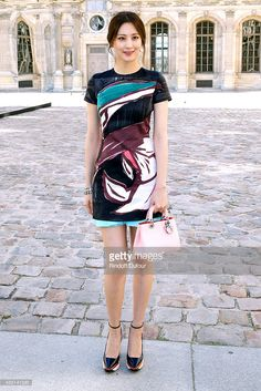 Actress Claudia Kim attends the Christian Dior show as part of the Paris Fashion Week Womenswear Spring/Summer 2015 on September 26, 2014 in Paris, France.