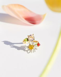 Graceful daisies, little green leaves and bright colorful ladybirds … These extremely delicate jewellery perfectly reflect the exceptional savoir-faire of Maison Les Néréides. Les Nereides, Jewelry Art, Jewellery, Delicate Jewelry, Jewelries, Daisies, Green Leaves, Bright, Colorful