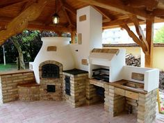 This is the way to do an outdoor kitchen correctly. Wood fired oven, multiple grills, smoker, ample counter space.
