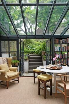 #houseaddition #houseextension / Take a peek at the most gorgeous glass houses we could find. Found on: http://www.houseandgarden.co.uk/outdoor-spaces/features/conservatory/library.