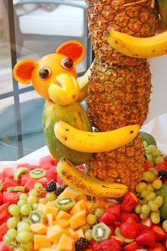 monkey made out of fruit on a pineapple tree