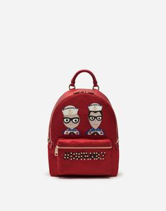 Family, love, and friendship are fundamental values for Dolce&Gabbana. Discover the whole Backpack from the Vulcano line in nylon with Designers' patches and micro stud appliqués: