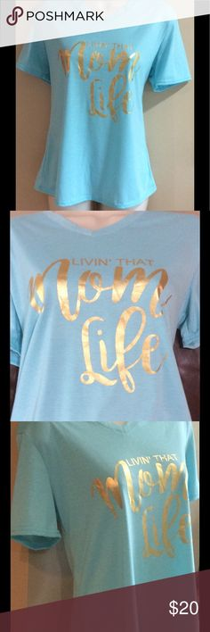 "🏖Livin' That Mom Life"" 🏖medium Brand new Tee that is mint color with gold writing.  women's medium. The shirt is 24 inches long. Armpit to Armpit is 18 inches. Tops Tees - Short Sleeve"