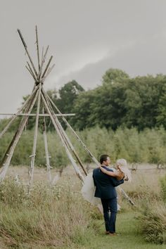 Newlyweds Bethany and Neal on the green grounds of Wisconsin's Woodwalk Gallery | Photo by Magdalene Photography