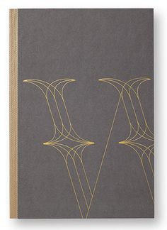 The 'W' is embossed in gold on the cover of the marketing book.
