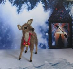 This little needle felted white tail fawn is ready to find her forever home. I have felted her from English wool and she stands 5 x 5. The three little bells are vintage. Please contact me if you have any questions.