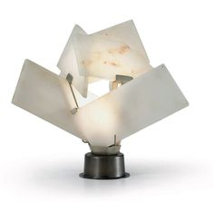 PIERRE CHAREAU (1883-1950) An Alabaster and Patinated Metal Table Lamp, circa 1925 9 in. (23 cm.) high