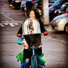 Mother cycling with baby