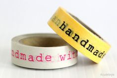 """*** this particular tape is more inconsistent with stickiness - sold as is, thus discounted***  handmade with love washi tape with typewriter font and yellowish background. The text are takes up quiet a bit of width, it's about 4 1/4"""" of text area. $1.80"""