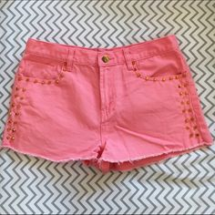Studded Shorts Coral gold studded shorts with frayed cut offs at bottom. Great condition except main button discoloration (shown in third pic). Forever 21 Shorts Jean Shorts