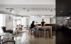 Restrained and minimalistic, Squarespaces Portland office has plenty of open spaces like this large circular open bar where coworkers can gather and swap ideas.