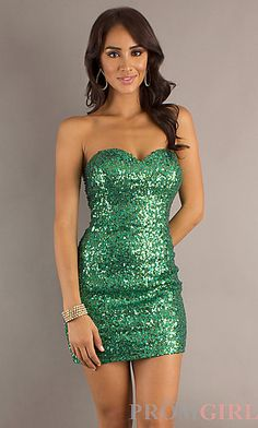 Short green fitted dress with lace, neck tie, and open back ...