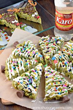 Only the best ingredients combine to make this recipe for HOLIDAY Scotcheroos! How adorable are these Christmas Trees and Reindeer? Plus a chewy, peanut butter treat is always a WIN! Made with Karo Syrup #ad