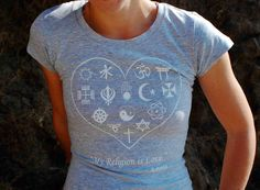My Religion is Love tee shirt, quote from Amma, the hugging saint.  Spiritual symbols of the world loving cradled inside a heart shape.. $12.00, via Etsy.