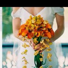 Flower ideas. Orange calla lillies with orchids hanging from string