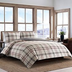 The large scale plaid of the Eddie Bauer Portage Bay Duvet Set offers a bold and updated casual look for your bedroom.  A neutral palette of putty and chrome is accented with beet red, made better by complimenting shams.