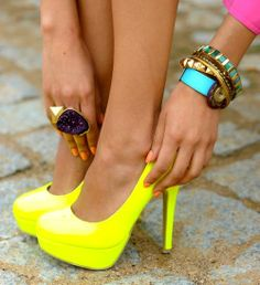big jewelry and neon shoes