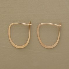 """BRUSHSTROKE HOOPS--Graceful self-locking swoops by Melissa Joy Manning are handmade in USA of recycled 14kt gold. 3/4""""L."""