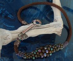 """""""Love is the Key"""" necklace. Glass bead crochet rope featuring decopaged antique key."""