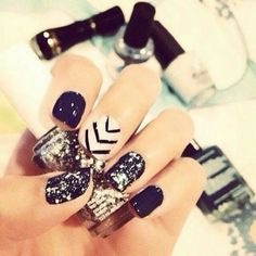 Navy nails eith nude accents.