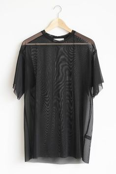 """Details Size Shipping • 100% Polyester • Mesh oversize tee. • Hand Wash • Line dry • Imported • Measured from small • Length 30"""" • Chest 12"""" • Waist 22"""" Free do"""