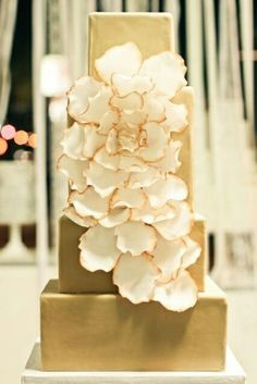 Shimmering gold cake with delicate gold-edged blossoms.