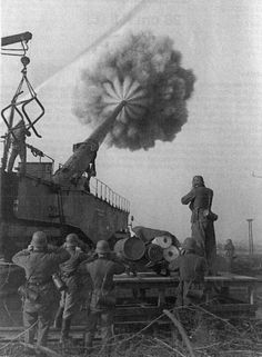 A German Krupp K5 283mm railway gun firing, WWII.