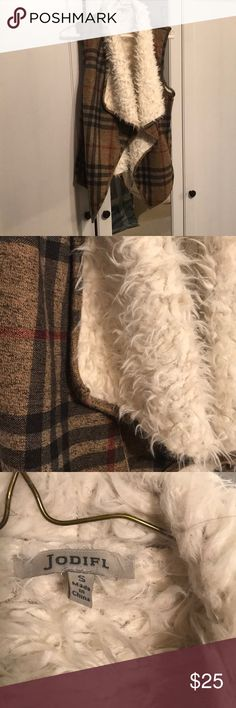 Plaid vest Soft shearing on the inside, plaid outside.  Warm and cozy.  Pockets!  Never worn Jackets & Coats Vests