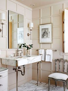 Room of the Day: like this ensemble - blush pink board and batten, sleek marble sink surround, sconces, silver chair, black and white art, marble floor, flower...elegant, original and chic 5.20.2013