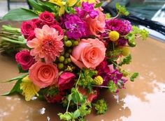 Vibrantly colored flowers for a summer wedding, one of our favorite combinations.