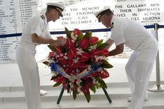 PEARL HARBOR (May 24, 2013) Capt. Wallace Lovely, mission commander of Pacific Partnership 2013 and Cmdr. Michael Harris, commanding officer of the amphibious dock landing ship USS Pearl Harbor, place a wreath at the USS Arizona Memorial during a wreath laying ceremony.