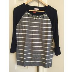 Merona Jeweled Neckline Sweater Cute & classy Merona sweater with silver and black jewels on the neckline. Back of the sweater is all black. Super great quality and still has tags on it (tags will be removed before shipped to you) and has never been worn! This top is 24 inches from the shoulder to the bottom. Price is negotiable and all offers will be considered. Comment any questions!  Merona Sweaters