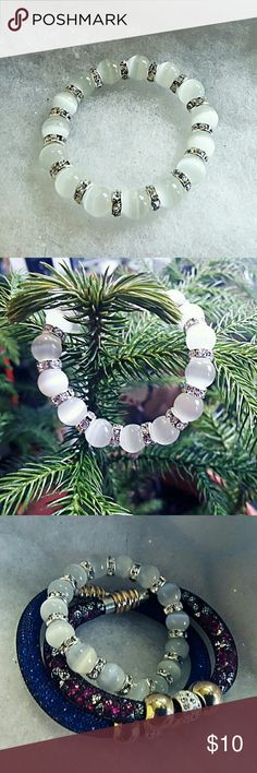 White glass bead & clear crystal stretch bracelet Fashion stretch bracelet featuring 10mm white fiber optic glass beads and 3mm x 8mm silver tone crystal wheel spacer beads. This would be stunning with any holiday outfit. Jewelry Bracelets