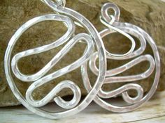 Funky Hoop Earrings Aluminum Wire Earrings Hammered Aluminum Earrings Wire Wrapped Jewelry Handmade Wave Hoops Clip On Available. $11.75, via Etsy.