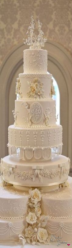 I count six tiers of beauty that are carried out in a variety of textures, styles and patterns. The intricate piping is spot-on, and the overall look is elegance personified.