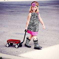 This is so Sarah.  She has a red ladybug rain boots and coat now.  Her brother Luke likes the boots....ummm