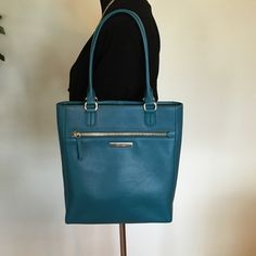 """Price Drop!!!GORGEOUS Teal Cole Haan Purse❤️ The Melbourne Magazine Tote by Cole Haan. This is the most beautiful handbag! The color is called """"Ernest Teal"""". The pictures do not do the purse justice. It has one large outside zipper pocket, one inside zipper pocket, and two small inside pockets to store a cell phone or other small trinkets. I only used it for a month and it is in excellent condition. Cole Haan Bags Totes"""