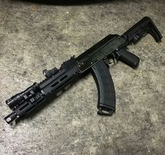 AK47 Pattern rifle with equipment from troyindustries, magpul, ,missionfirsttactical ,slrrifleworks, arsonmachine ,usmachinegun, surefire. burrisfastfire, ultimak