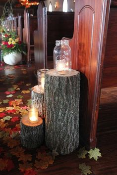 Perfect fall accents - votives in mason jars on tree stumps {Smith Squared Photography}