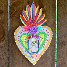 Mexican Tin Folk Art: Make Mexican tin folk art with simple items from the hardware store and supplies I'll be you already have. Mexican Crafts, Mexican Folk Art, Tin Can Crafts, Arts And Crafts, Yarn Organization, Tin Art, Art Deco Posters, Mexican Designs, Arte Popular