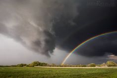 About as close as you can get to a tornado without it happening. Funnel cloud rotates in front of a double rainbow in Dublin, Texas on April 13, 2014.